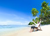 Happy Businessman Working on a Tropical Beach