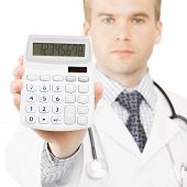 Medical doctor isolated on white with a calculator