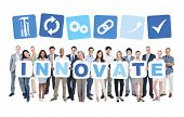 Multi-ethnic Group of Business People Holding Boards with Innovate