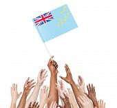 Diverse Multiethnic Hands Holding and Reaching For The Flag of Tuvalu