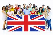 image of united we stand  - Large Group of People Holding United Kingdom Flag - JPG