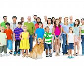 Multi-ethnic Group of Mixed Age People With Golden Retriever Dog
