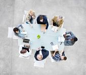 stock photo of directional  - Group Of  Business People Meeting at Conference Table - JPG