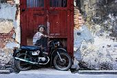 General view of a mural 'Boy on a Bike' painted by Ernest Zacharevic in Penang on DEcember 28 2013.
