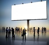 Silhouette of Business People With Blank Billboard