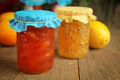 Citrus and ginger jam and orange marmalade on wood table