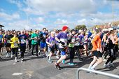 HASTINGS, ENGLAND - MARCH 23, 2014: Runners take part in the annual Hastings Half Marathon race at H