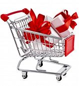 Shopping basket cart with gift boxes - isolated on white background