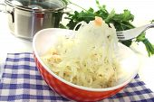 picture of cruciferous  - fresh Sauerkraut on a fork before light background - JPG
