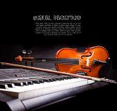 Violin and piano keys on black