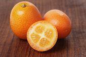 Fresh Kumquat On Wood Table