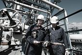 picture of refinery  - oil and gas workers inside large petrochemical oil refinery - JPG