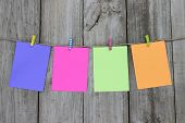 Colorful blank note cards hanging on clothesline