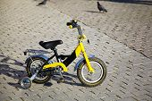 Children's yellow bicycle