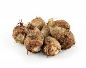 foto of taro corms  - fresh taro roots on over white background - JPG