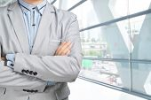 Young Businessman In Suit Standing