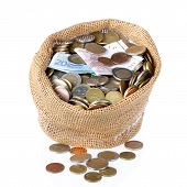 Money Bag With Coins And Banknotes Isolated Over White