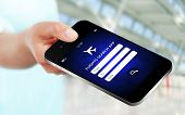 Hand Holding Mobile Phone With Flights Research Application