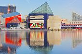Baltimore National Aquarium and historic submarine reflections in icy waters