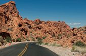 stock photo of valley fire  - Main road going through the varicolored rocks of Valley of Fire State Park located near Las Vegas USA  - JPG
