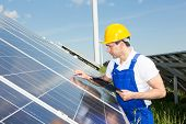 Engineer Inspects Solar Panels At Energy Park