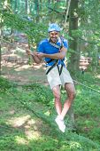 image of ropeway  - Man sliding on ropeway at high rope course - JPG