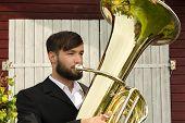 Male Musician Playing Tuba