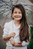 small girl with lace umbrella