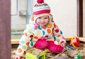 Cute Little Girl In A Sandbox