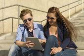 Happy Couple Having Fun With Tablet Pc