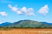 Landscape With Mountain Views, Blue Sky And Beautiful Clouds.