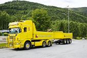 Yellow cargo truck with a trailer