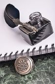 stock photo of inkwells  - antique vintage blue pen and inkwell on the paper - JPG