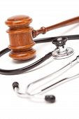 Black Stethoscope And Gavel On White