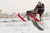 Sportsman on snowmobile on track