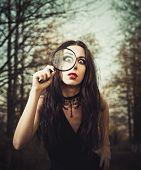 Strange Goth Girl Looks Through A Loupe