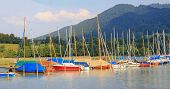 Colorful Sailboats At The Lakeside Of Tegernsee, German Landscape