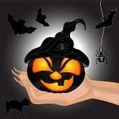 Scary Pumpkin On A Hand At Witch