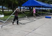 The Workers Are Uninstalling The Big Tent In Front Of Chiangmai University Conference Hall After The
