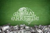Global marketing concept on blackboard