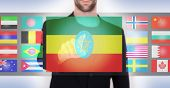 picture of ethiopia  - Hand pushing on a touch screen interface choosing language or country Ethiopia - JPG