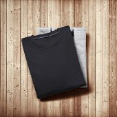 Two Jumpers On Wood Background