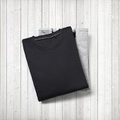 Two Blank Jumpers On White Wood Background