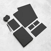 Black Branding Elements On White Concrete Background