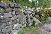 image of old stone fence  - Old stone fence covered with moss Lappeenranta Finland - JPG