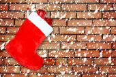 Red Christmas Boot With Gifts On Background Brick Wall