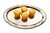 Four Corm Muffins Served On A Silver Tray