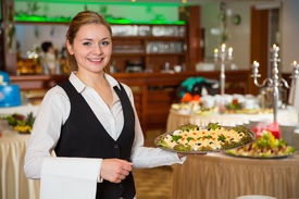 foto of buffet catering  - Catering service employee or waitress posing with a tray of appetizers - JPG