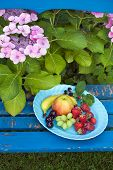 Nutritious Fruits On Plate On Top Of The Chair