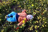 Little Baby Lying Among The Flowers